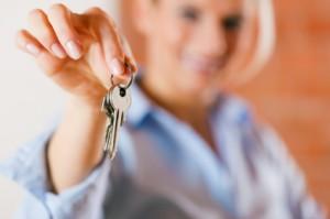 Realtor handing house keys